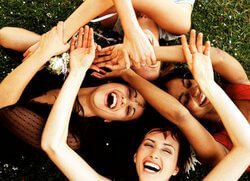 Happy women lying down with arms up